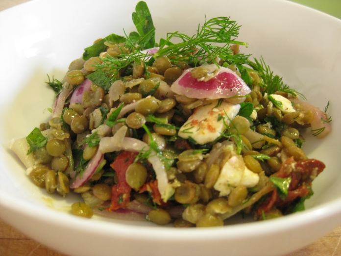 Lentil salad with sun-dried tomatoes and dill.